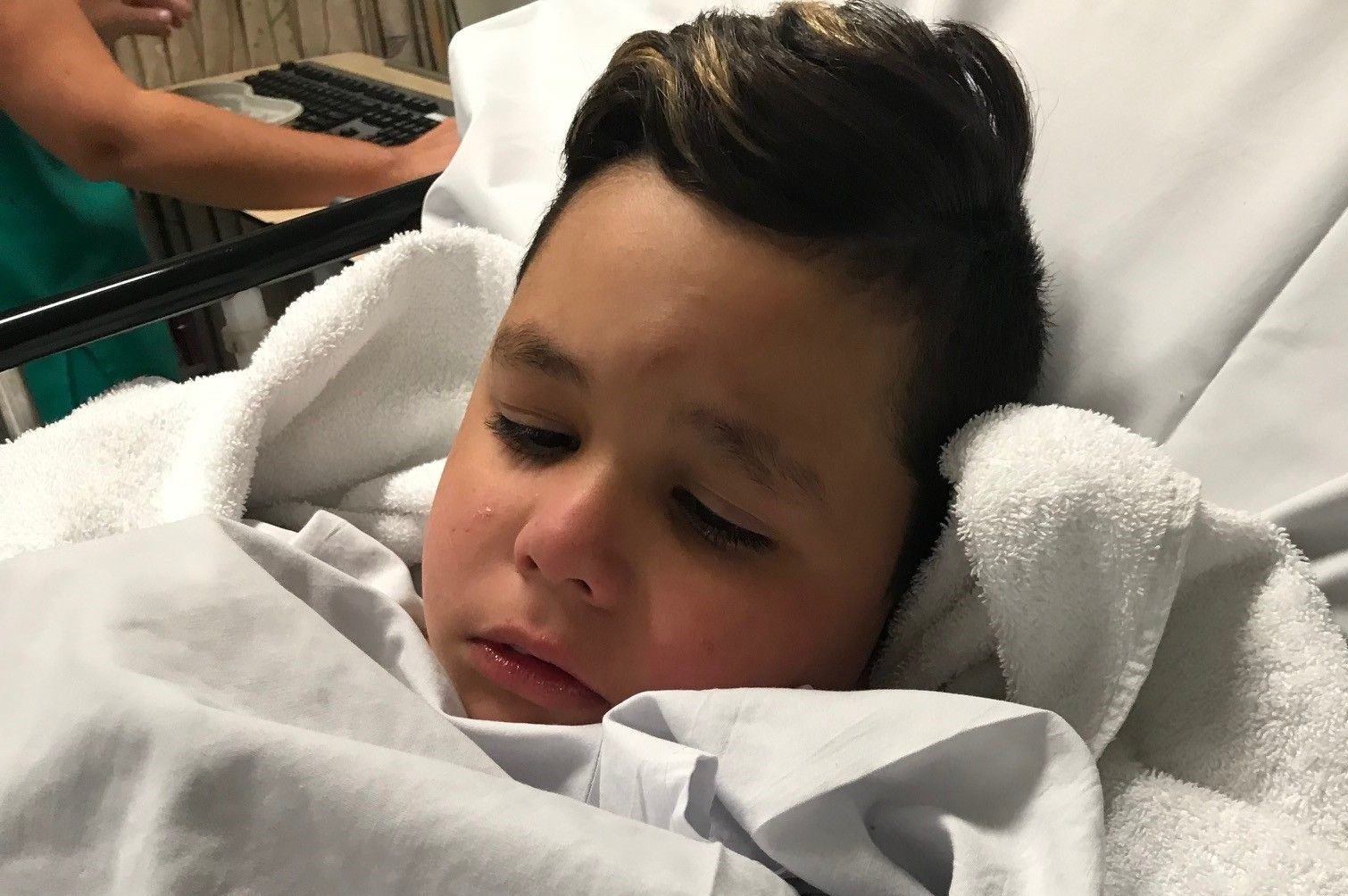 Cem awaits surgery in his hospital bed