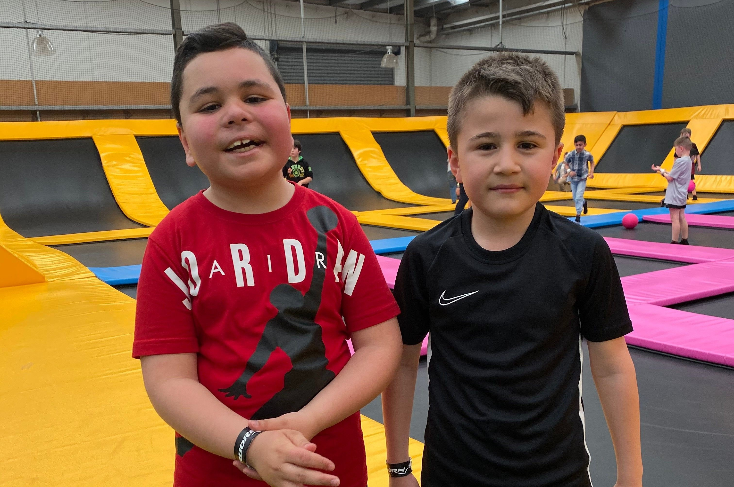 Cem and his cousin at a trampoline play centre